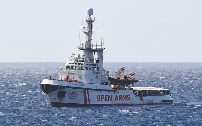 Spain to take some migrants on Open Arms ship, says Italy