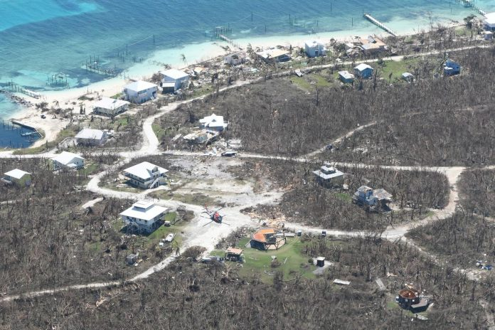 Bahamas hurricane survivors tell of children swept away; death toll reaches 30