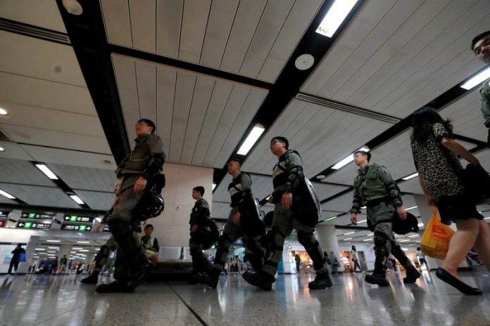 Hong Kong police in position at airport ahead of planned protest