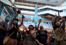 Hong Kong police storm mall as protest turns violent