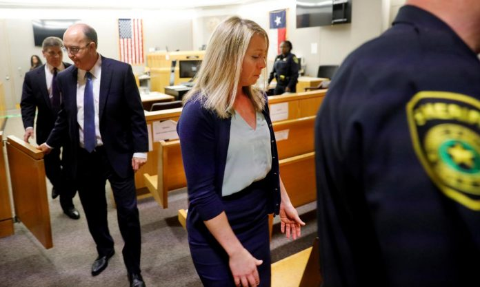 Ex-Texas officer sentenced to 10 years in prison for killing neighbor in his apartment
