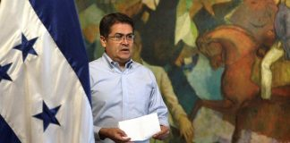 Honduran president hobbled after being implicated in brother's bribery conviction