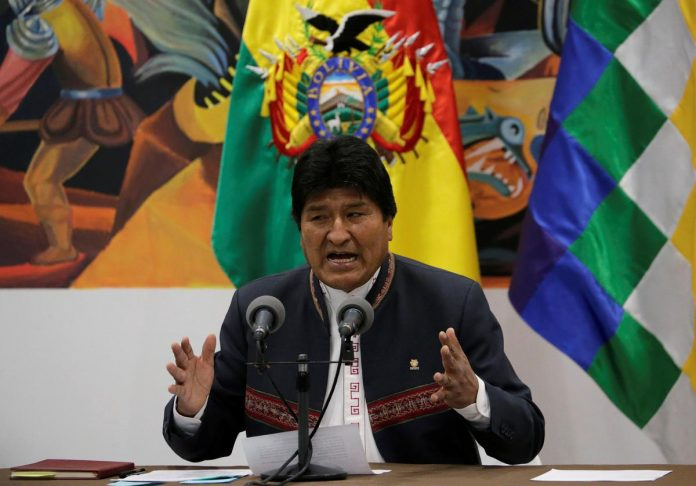 Bolivia's Morales vows second-round vote if fraud found in election, threatens siege of cities