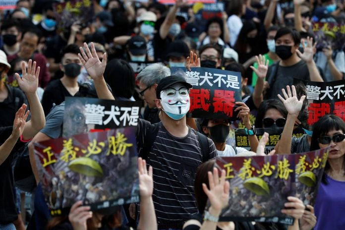 Hong Kong protesters, police in dusk standoff after tear gas breaks up rally