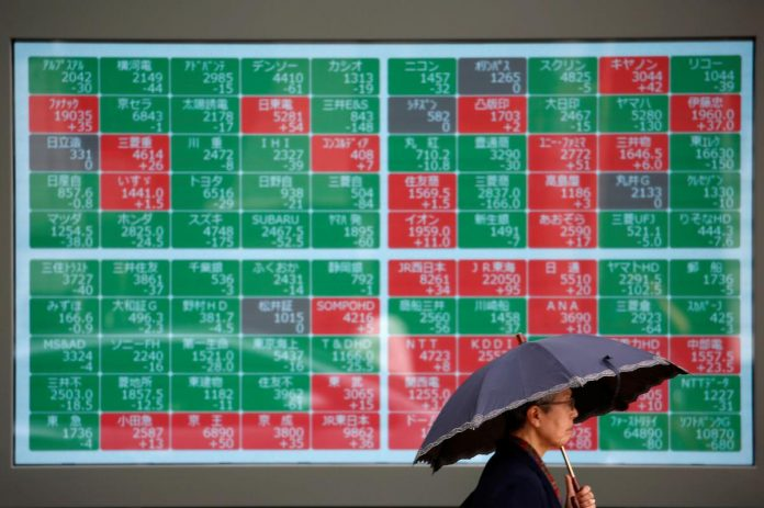 Asian shares rise to three-month highs, dollar waits for Fed