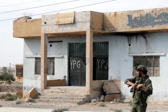 Turkey says Kurdish YPG forces have not fully withdrawn from Syria border area