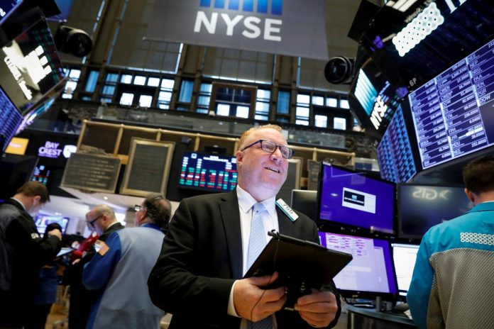 Wall Street edges higher at open after strong Apple, Facebook results