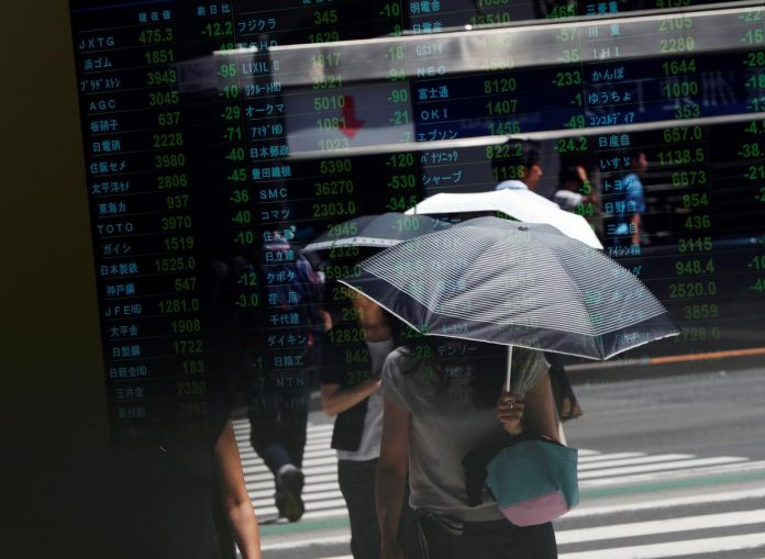 Stocks grind lower as markets await clues on trade talks