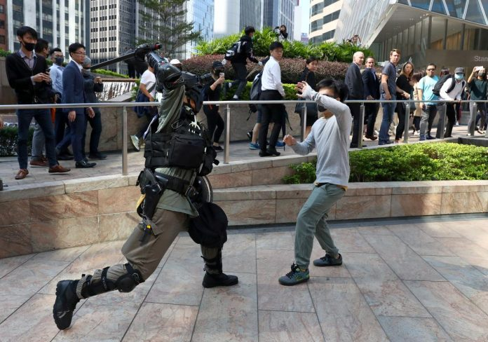 Protesters block central Hong Kong streets as chaos grips city