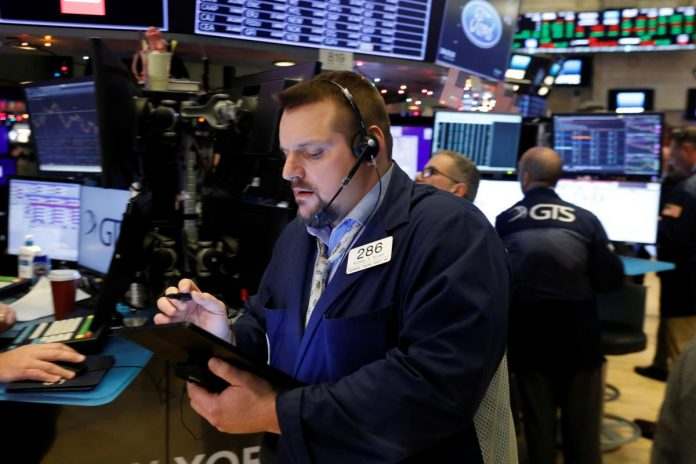 Wall Street bides its time, awaiting news from trade front
