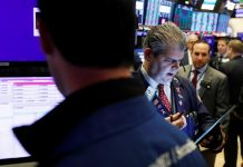 Wall St falls as health, tech shares drag, tariff deadline looms