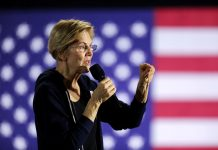 Warren takes aim at U.S. Democratic rivals with attack on big money