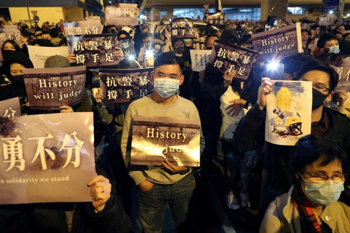 Hong Kong protesters face off with police in mall protests