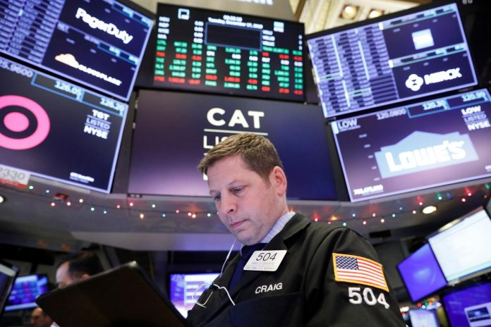 Wall St. slips from near-record highs in Christmas Eve trade