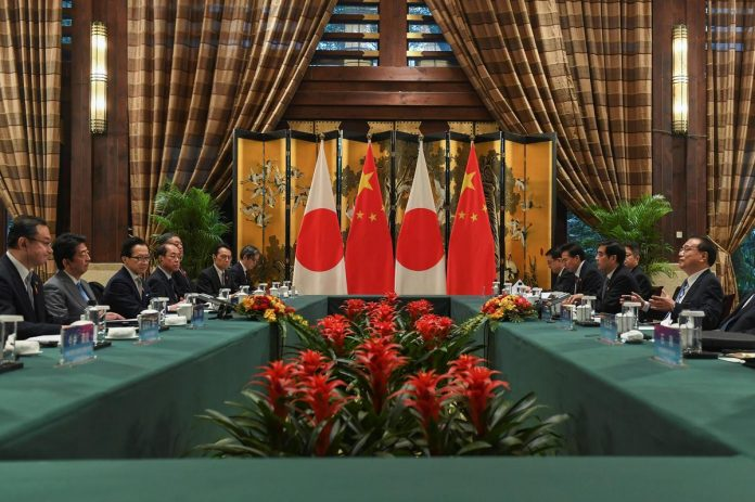 Japan's Abe tells China no improvement in ties without stability in East China Sea