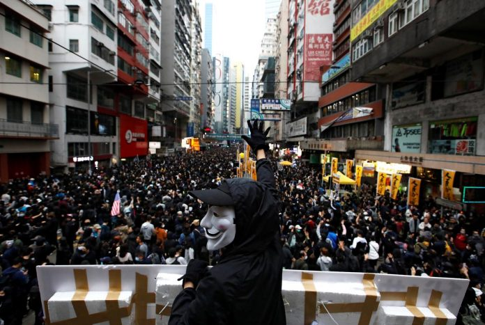 Hundreds arrested in Hong Kong in New Year's Day protests: police