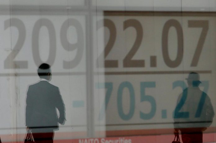 Asian shares stumble, oil surges after U.S. air strikes in Iraq