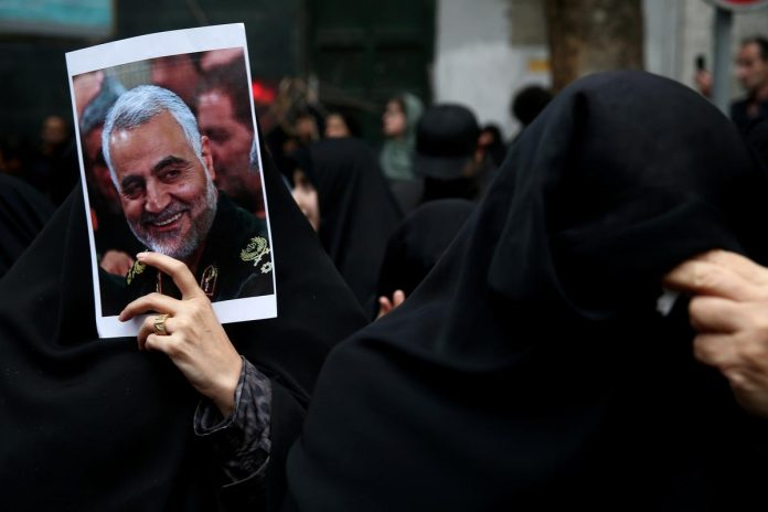 Wailing in grief, Iranians flock to mourn slain commander
