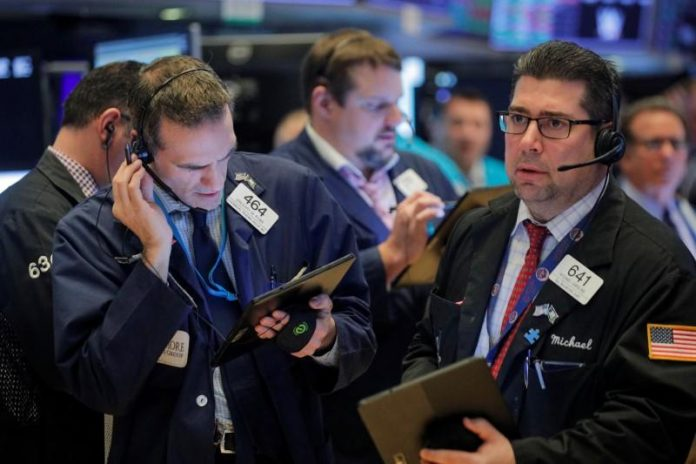 Wall Street hovers near all-time high as trade deal, earnings awaited