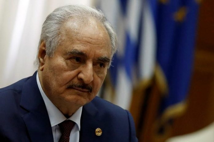 Libyan commander's forces choke oil flows, overshadowing peace summit