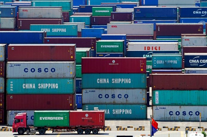 China to halve tariffs on some U.S. imports as virus risks grow