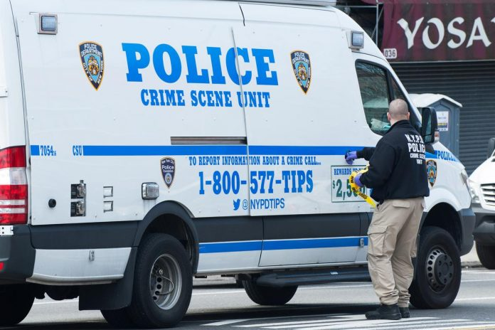 Gunman wounds NYC police officer inside station hours after ambushing patrol officers