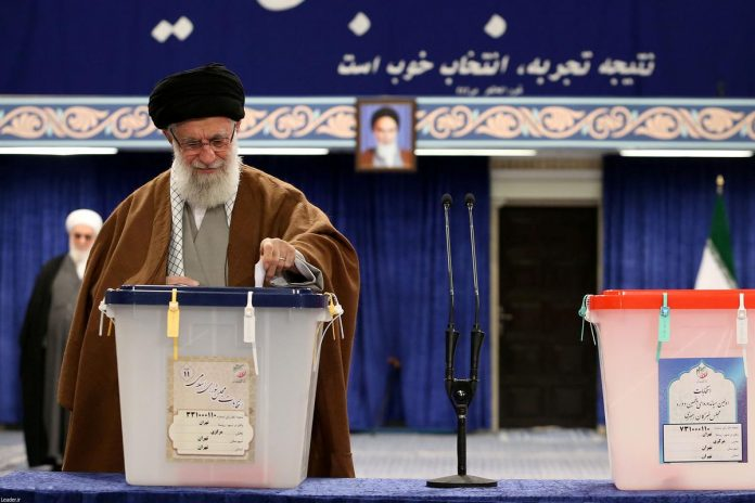 Iranians vote in parliamentary election, hardliners set to cement grip