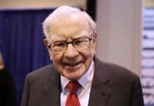 Rising stocks fuel record profit for Buffett's Berkshire; operating profit falls