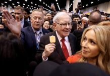 Buffett defends Berkshire stock push, reassures on future as profit smashes record