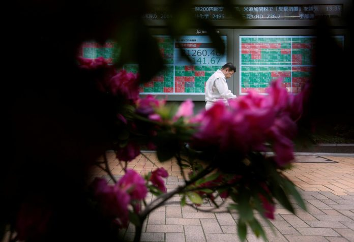 Asian shares slump, bonds rally as virus fears grow
