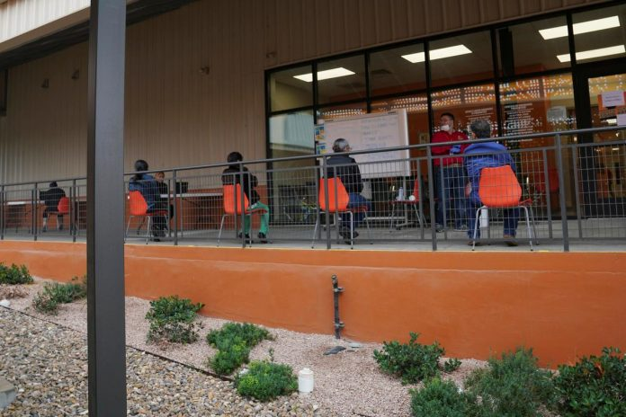 Layoffs and food lines: How the pandemic slams the poorest U.S. workers