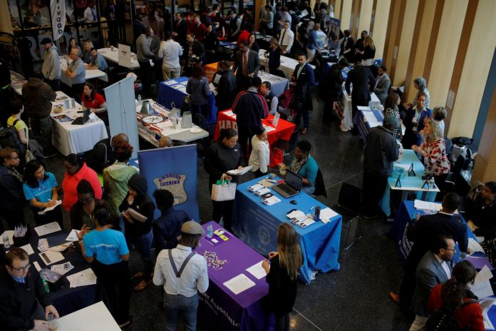 U.S. weekly jobless claims soar to record 3.28 million