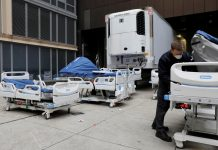 U.S. rushes to build makeshift hospitals as death toll rises by 800