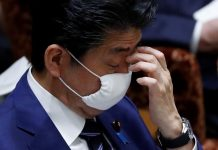 On brink of coronavirus crisis, Japan PM offers masks, gets social media roasting