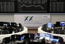 Global stocks turn negative as virus death toll mounts