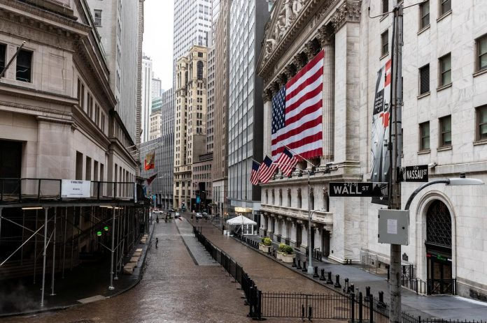 Wall Street down on flight from techs; move to value limits loss on Dow, S&P 500