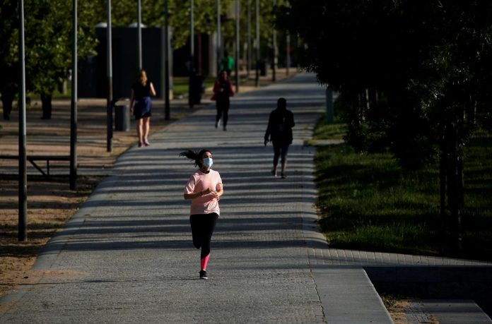 Free at last! Spaniards get outside to exercise after 49 days of lockdown