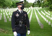 U.S. marks hushed Memorial Day holiday as virus deaths near 100,000