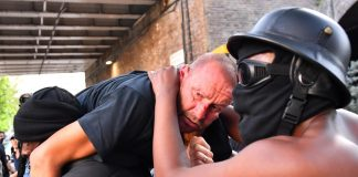 Far-right and anti-racism protesters scuffle in London